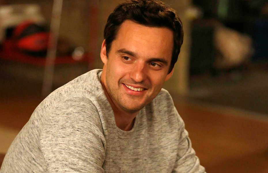 """NEW GIRL:  Nick (Jake Johnson) isn't sure how to react when Schmidt buys him a cookie in the """"Models"""" episode of NEW GIRL airing Tuesday, Oct. 23 (9:00-9:30 PM ET/PT) on FOX.  ©2012 Fox Broadcasting Co.  Cr:  Greg Gayne/FOX"""