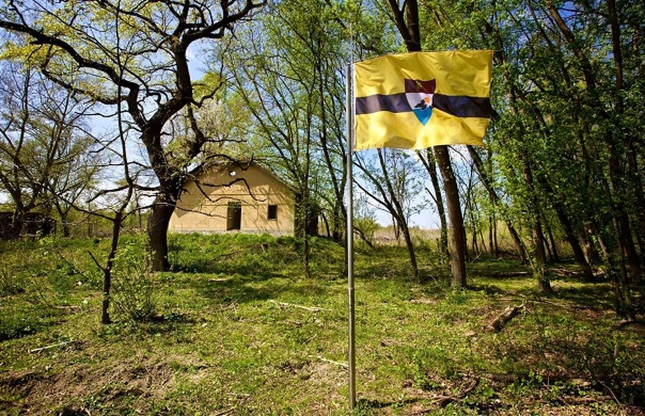 Mandatory Credit: Photo by CROPIX/SIPA/REX Shutterstock (4666638d) The flag of Liberland Czech man proclaims new sovereign state of Liberland between Serbia and Croatia - 15 Apr 2015 The no-man's land between Serbia and Croatia was declared, at 7 sq. km, the smallest independent sovereign state in the Balkans.  It is 'Liberland', to which its 'President', Czech Vit Jedlicka, invites all who respect the principle 'live and let live', and are not extremists.  Liberland lies on the banks of the Danube between Backi Monostor and Zmajevac. Jedlicka claims that it was created entirely in accordance with international law as it is based on the no-man's land which was not claimed either by Serbia or Croatia in the process of demarcation. Vit Jedlicka, from the fringe party of the right wing close to the former Czech leader Vaclav Klaus, expressed hope in a statement that 'an independent, sovereign Liberland', will first be recognized by Serbia and Croatia and then other countries of the world. Liberland has a flag, coat of arms, constitution and laws, and is already handing out citizenships and invites to those believing in peace. | Copyright (c) 2015 Rex Features. No use without permission.