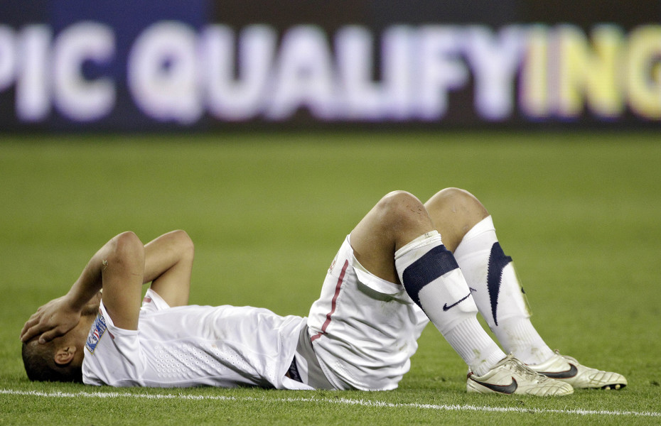 Terrence Boyd of the United States lies on the field after the United States tied 3-3 with El Salvador in a CONCACAF Olympic qualifying soccer match on Monday, March 26, 2012, in Nashville, Tenn. El Salvador scored in extra time to cause a 3-3 draw, eliminating the United States from Olympic qualifying. (AP Photo/Mark Humphrey) | AP2012