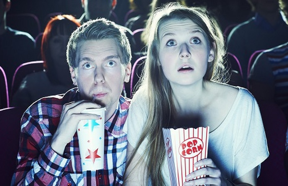 couple enjoying a movie at the cinema | (c) Brand New Images